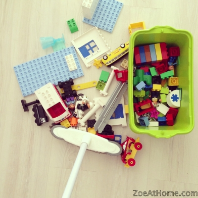 Decluttering with kids tip: sweep the toys into a pile before picking them up.
